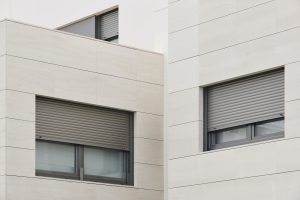 New building exterior facade with tiles. Construction. Buy, rent